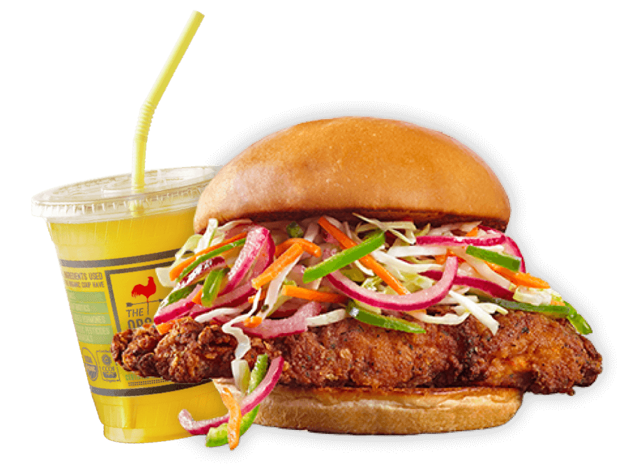 A crispy chicken sandwich and mango juice