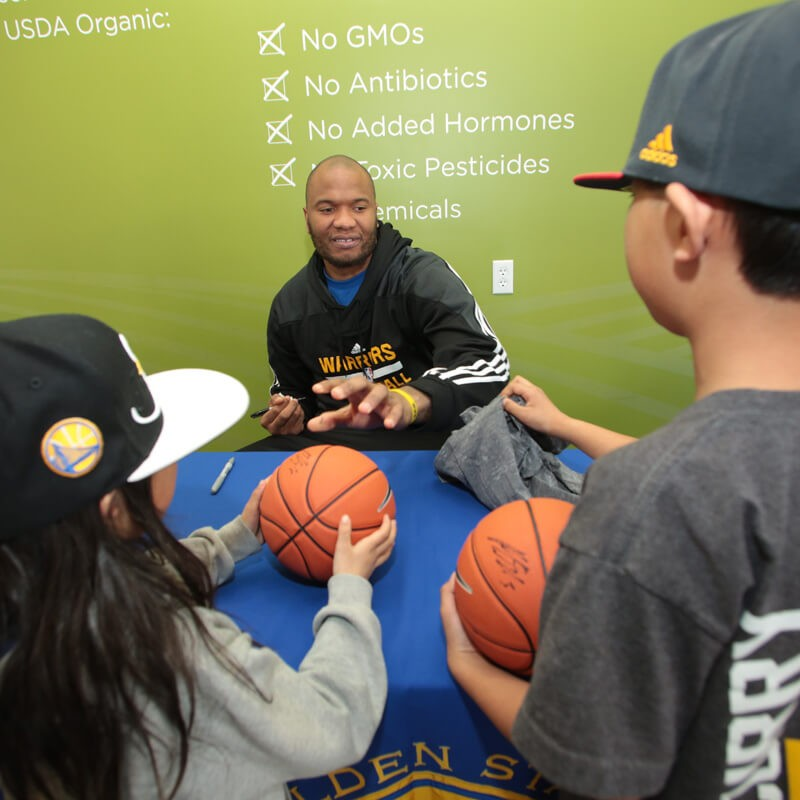 Marreese Speights signing basketballs