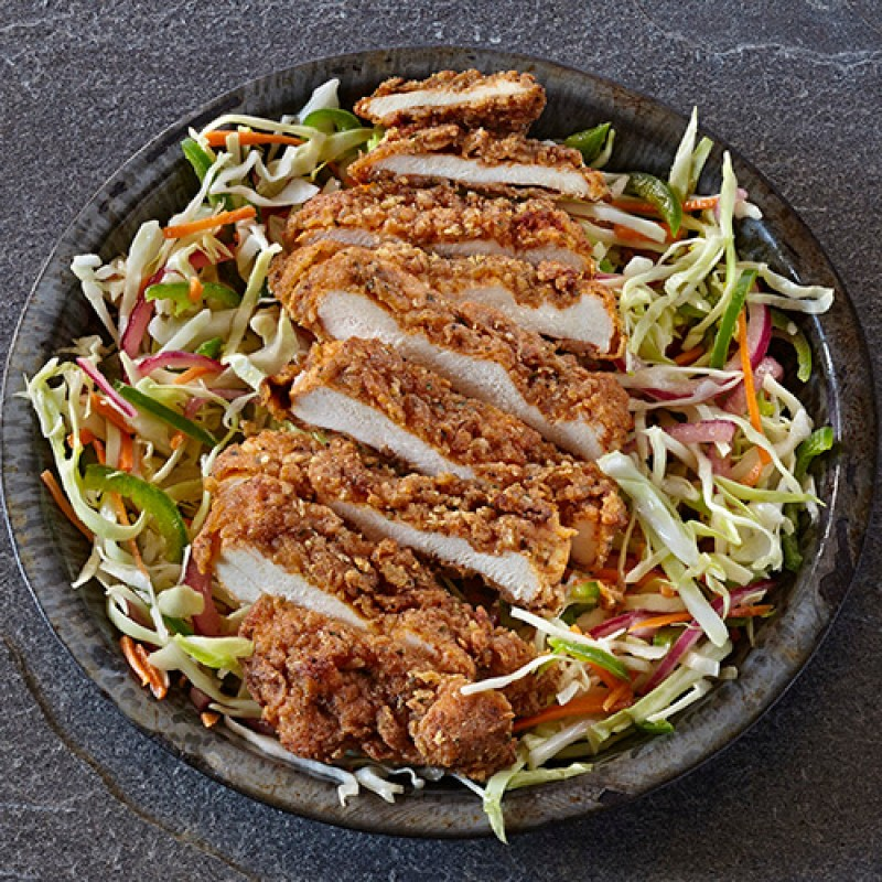 A salad with crispy chicken
