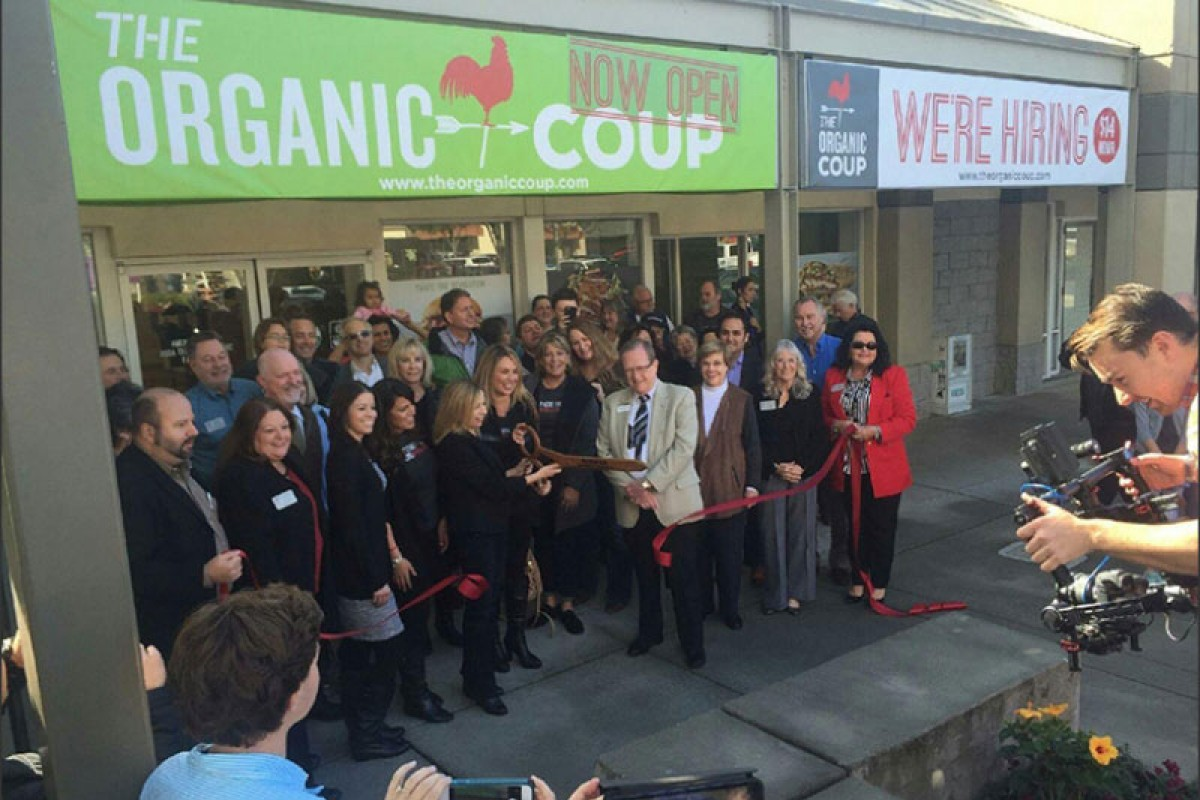 The Organic Coup team outside of a new location