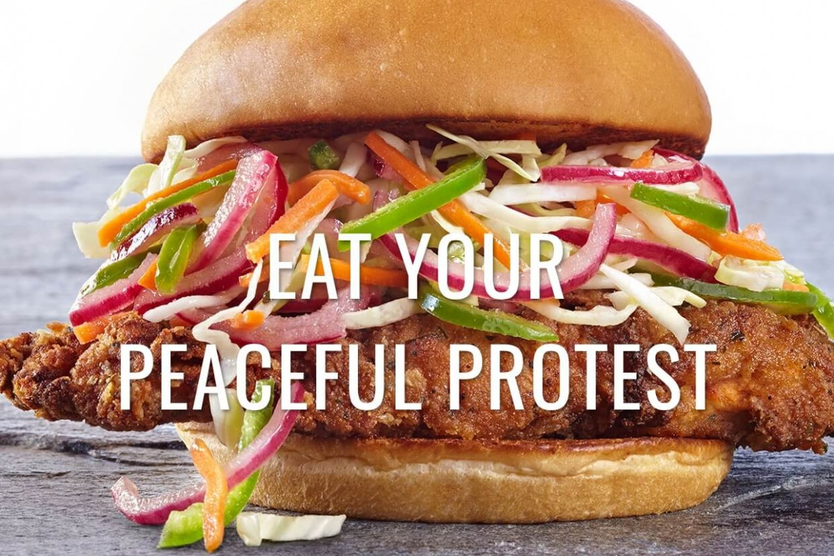 An Organic Coup Chicken Sandwich overlaid with the text